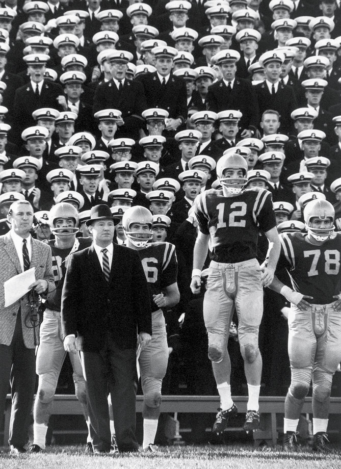 Staubach won the Heisman trophy in 1963 as the quarterback at the Naval Academy. Although he was drafted by the Dallas Cowboys, he still had to perform his required post-graduation service time. Staubach served in the Navy Supply Corps from 1964 to 1968, which included a tour of duty in Vietnam. After his service, Staubach joined the Cowboys and led them to two Super Bowl victories, in 1972 and 1978.