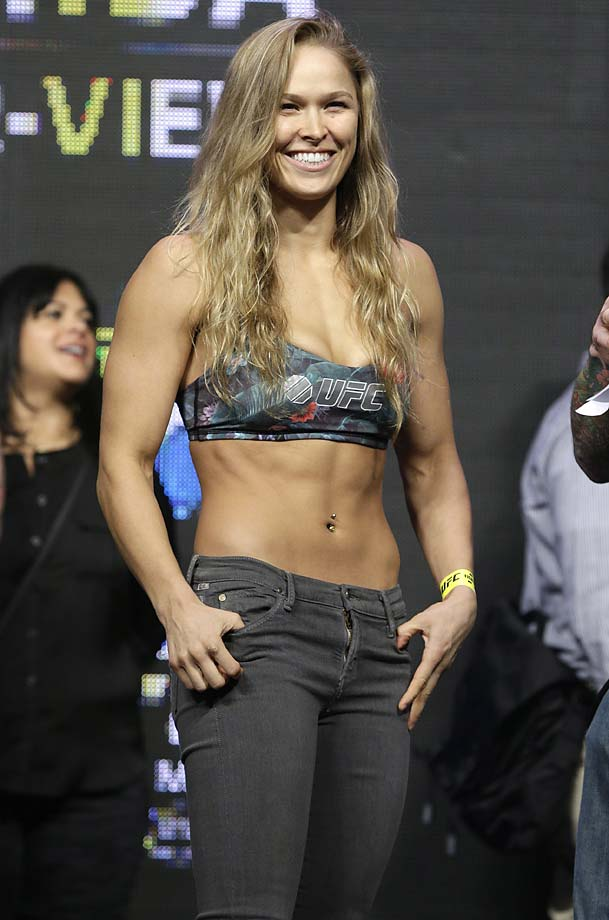 Ronda Rousey smiles at a weigh-in for the UFC 175 event at the Mandalay Bay in Las Vegas.