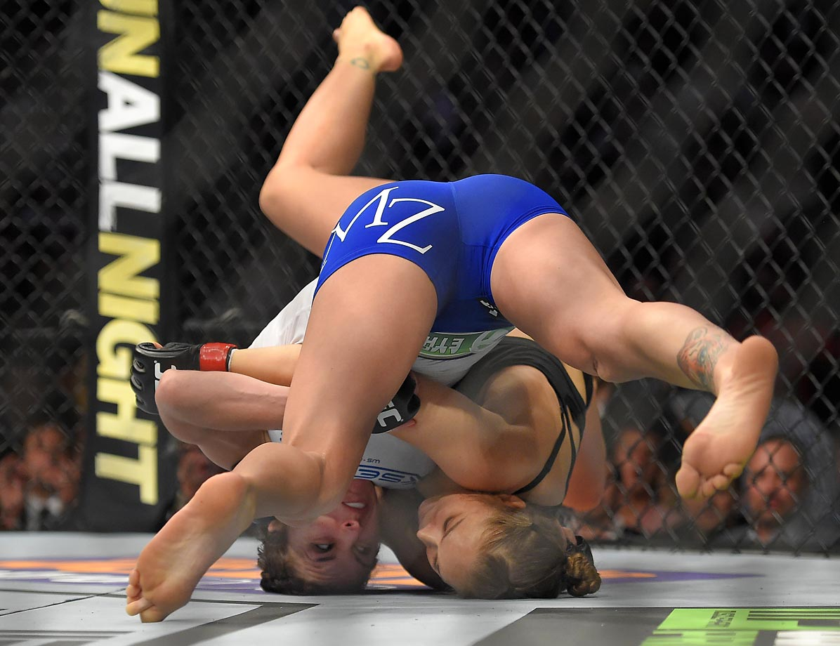 Ronda Rousey (right) grapples with Cat Zingano during a UFC 184 mixed martial arts bantamweight title bout. Rousey won after Zingano tapped out 14 seconds into the first round.