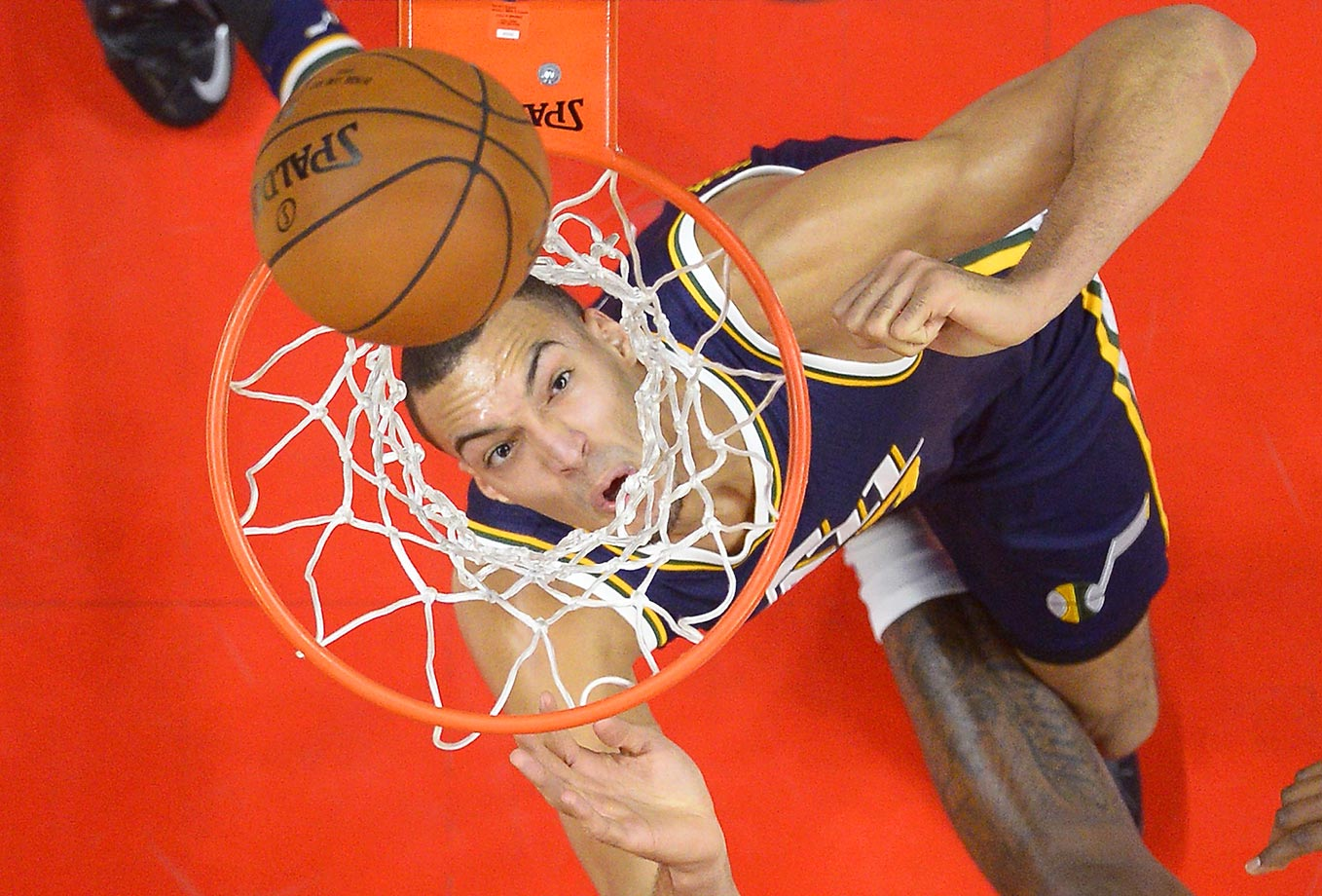 Rudy Gobert of the Utah Jazz watches a basket through the net in a game against the Los Angeles Clippers.