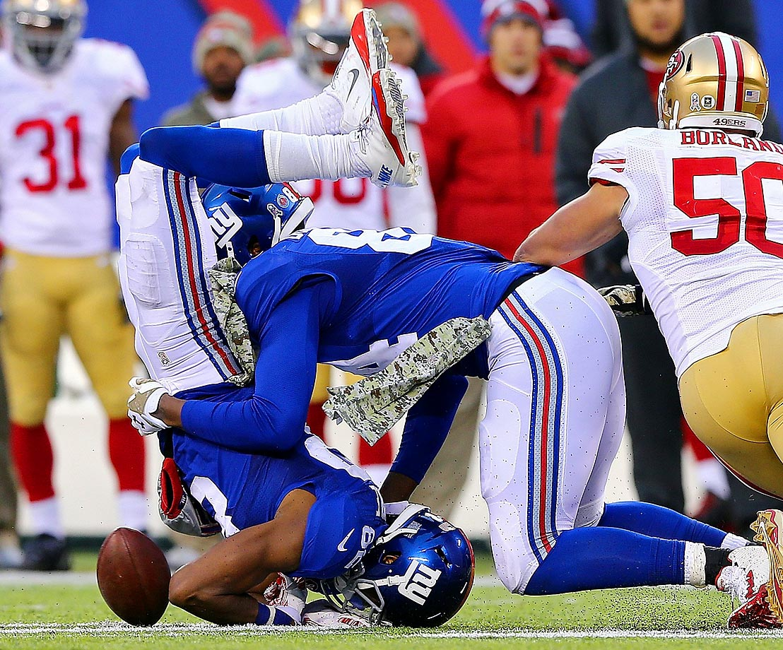 Rueben Randle collides with teammate Larry Donnell while losing the ball in a game against San Francisco. He wasn't credited with a fumble on this play.