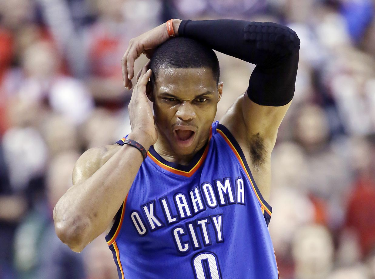 Thunder guard Russell Westbrook appears to be in pain.  He scored 40 points but missed an opportunity to tie the game, making only two of three free throws with just seconds left, letting Portland win 115-112.
