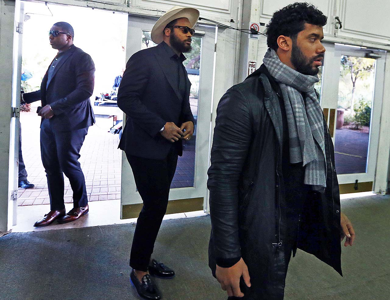 Seattle tackle Russell Okung, left, defensive end Michael Benett, center, and quarterback Russell Wilson, right, before media availability on Sunday.