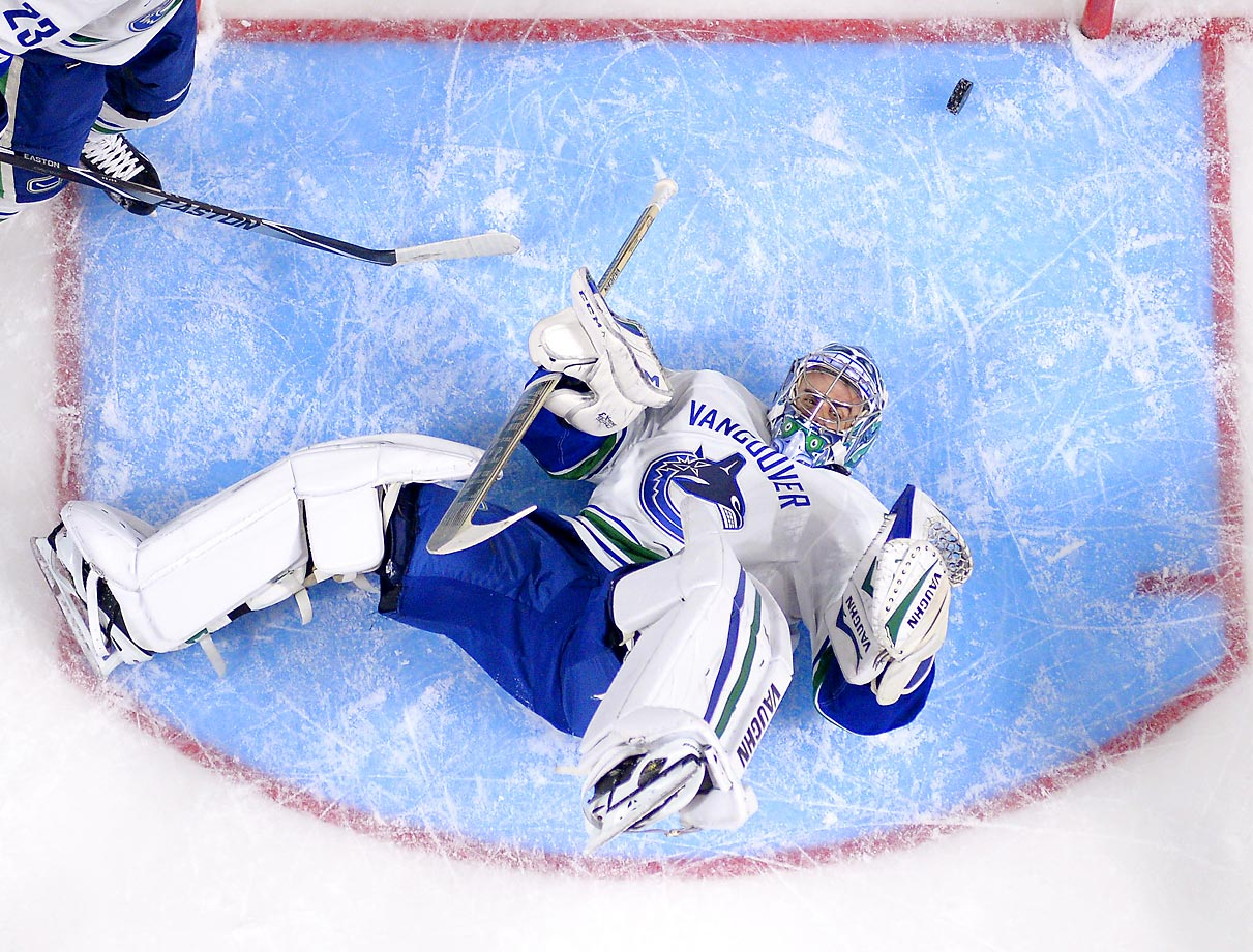 Vancouver Canucks goalie Ryan Miller is scored on by Los Angeles Kings right winger Marian Gaborik during the first period. The Kings won 5-1 at home.
