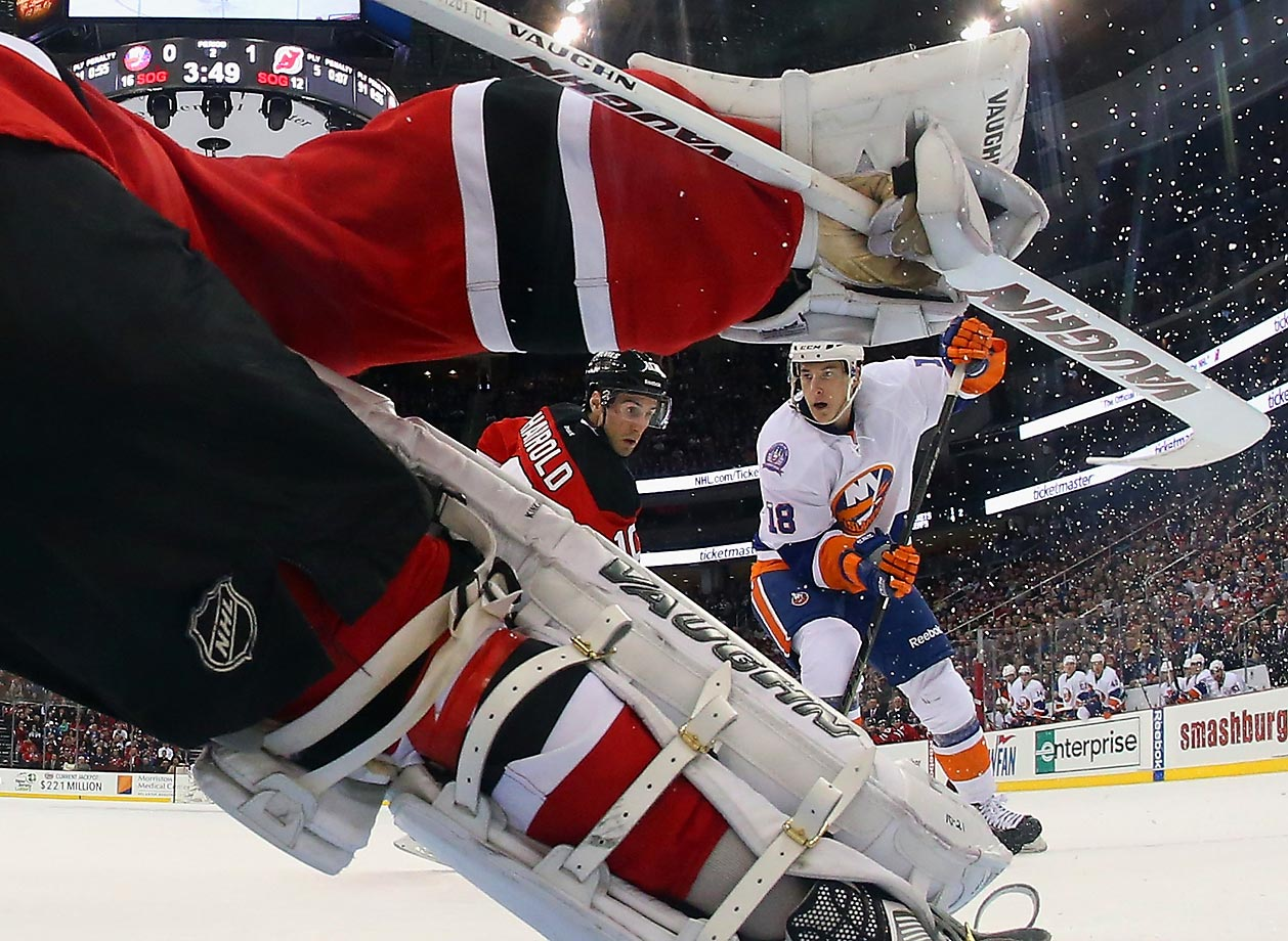 Ryan Strome of the New York Islanders moves in on Keith Kinkaid of the New Jersey Devils at the Prudential Center in Newark, N.J.