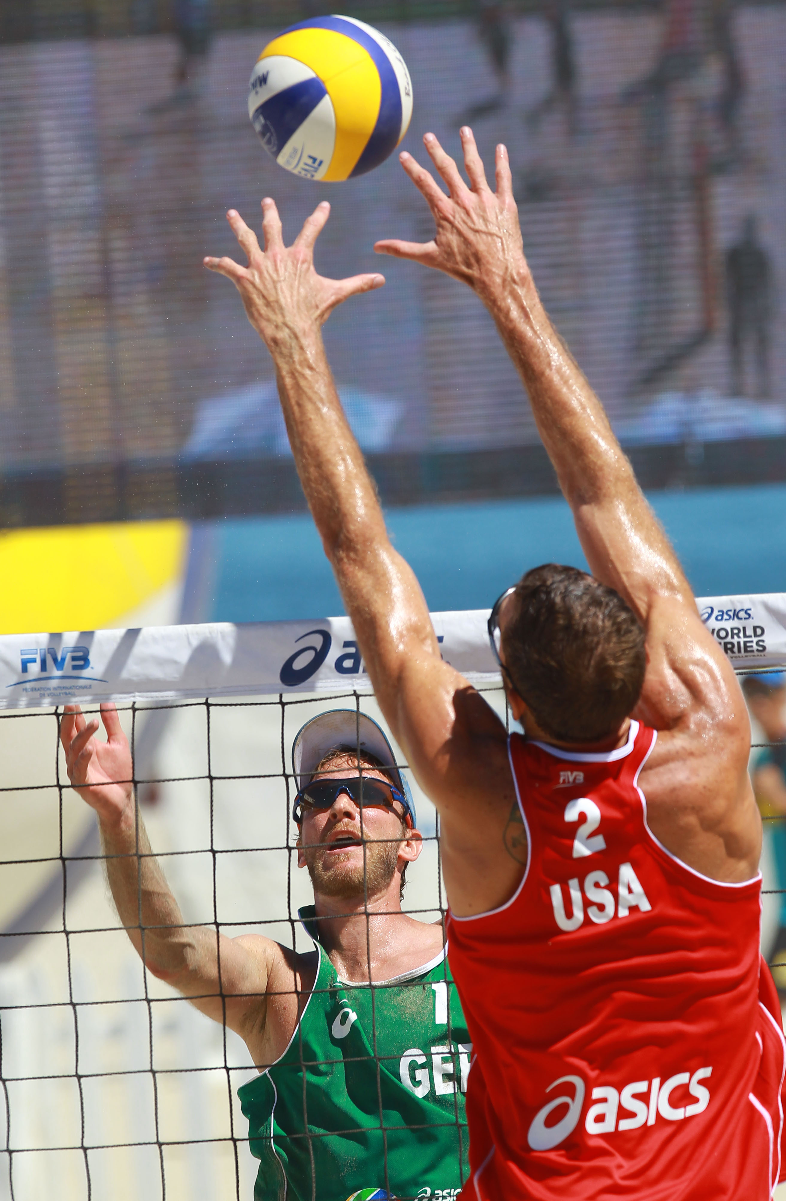 Ryan Doherty of the USA stretches to block German Sebastian Dollinger.