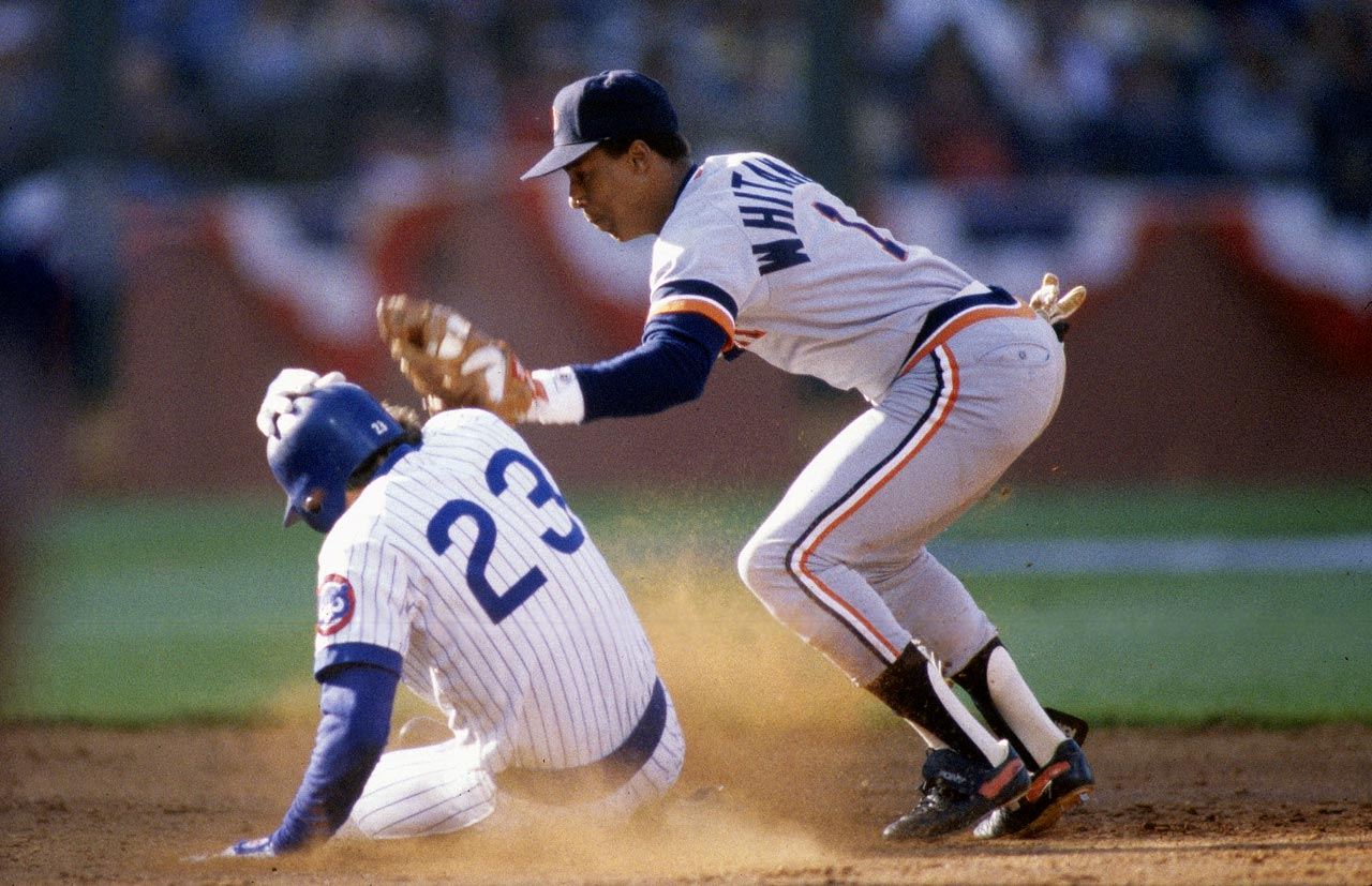 Ryne Sanberg slides under the tag of Lou Whitaker as he steals a base in the third inning.