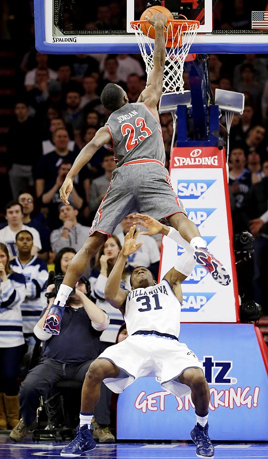 St. John's Rysheed Jordan goes up for a dunk over Villanova's Dylan Ennis.
