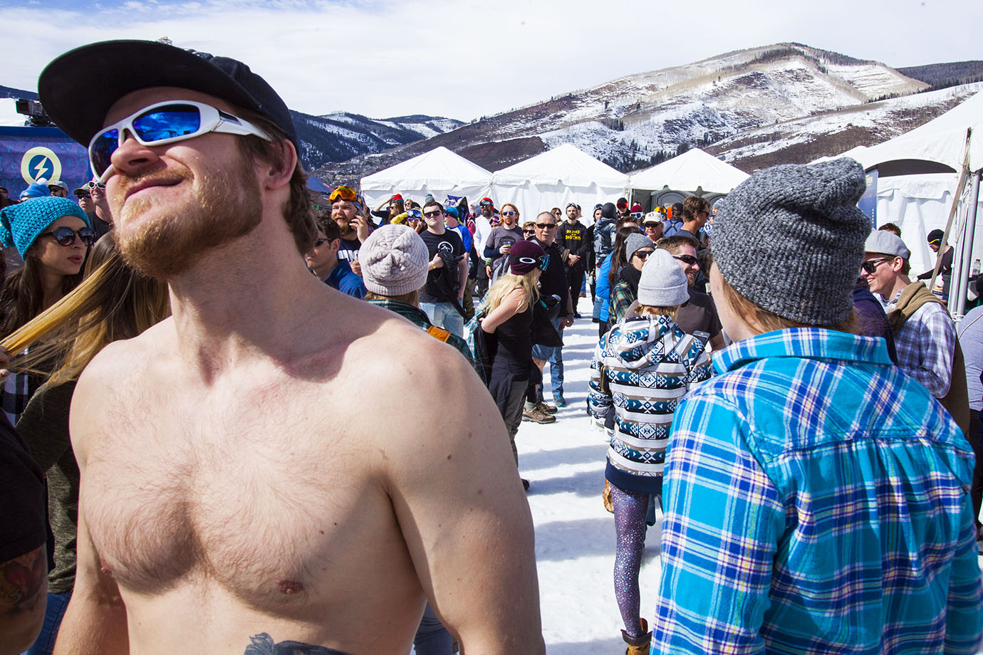 This fan was so enamored by the warm temperatures that he opted to go topless while waiting for the men's Superpipe final to begin. He was not alone.