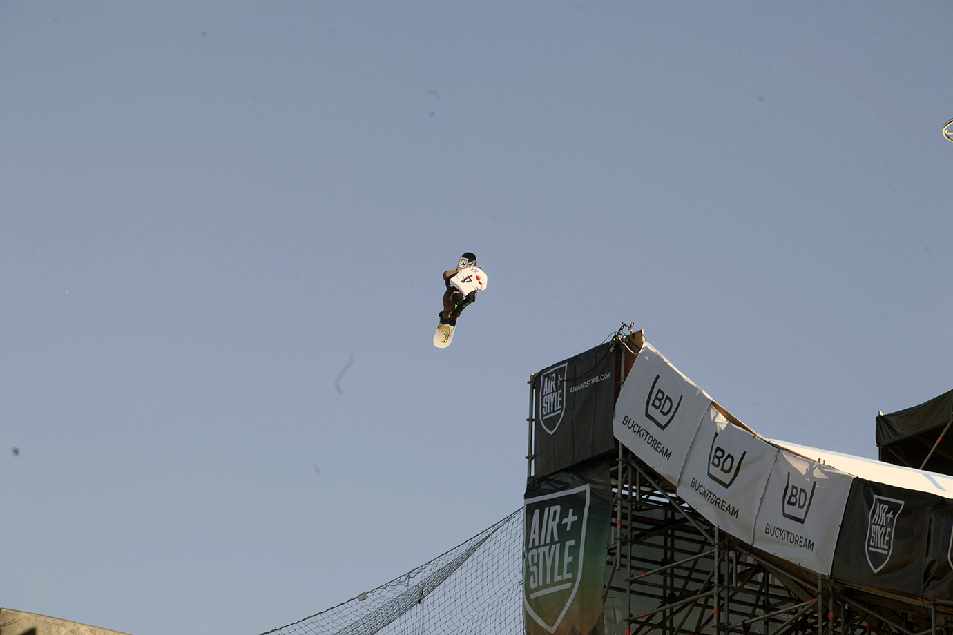 Torgeir Bergrem of Norway sails the gap between the launch point and the landing pad of the 160-foot big air jump during practice for the finals elimination rounds.
