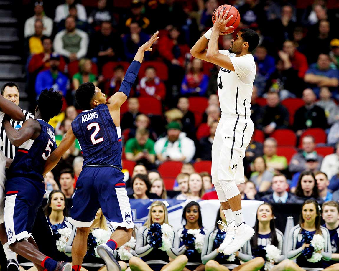 Xavier Talton of the Colorado Buffaloes gets off a shot against UConn.