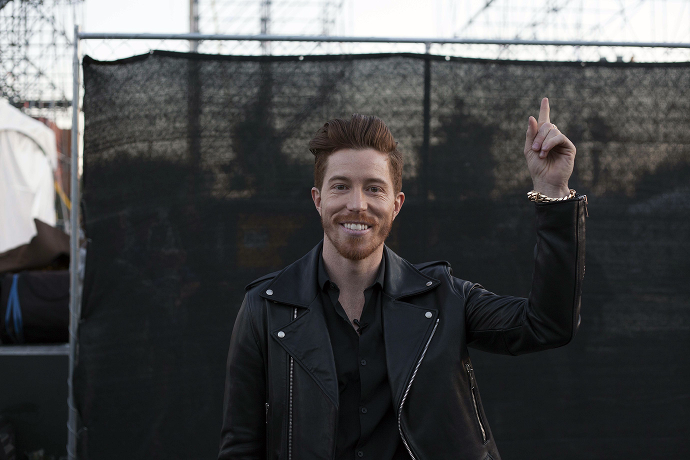 Shaun White is all smiles as he points up at his vision—to bring an event that combined music and snowboarding to the L.A. area—coming to fruition for a second time.