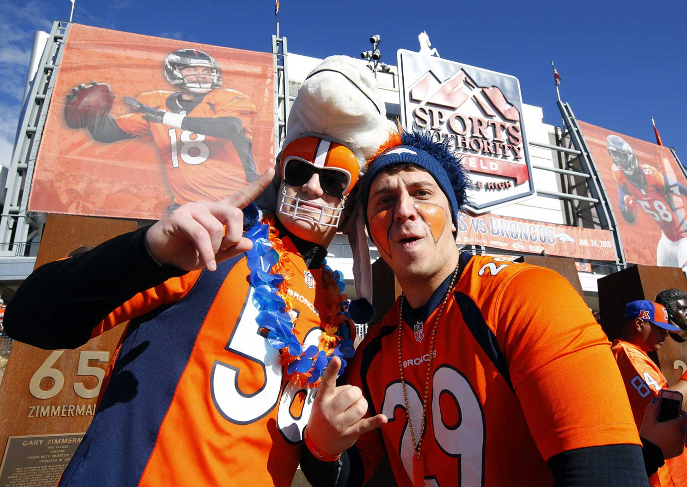 Denver Broncos fans wait to enter the stadium before the NFL AFC Championship game.