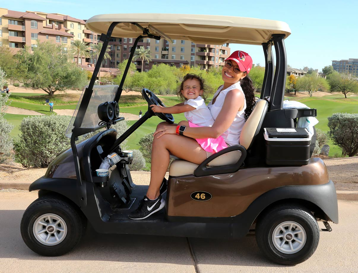 Jordin Sparks lets her niece Ava take the wheel of her golf cart at the 3rd Annual Arians Family Foundation Arizona Celebrity Golf Classic in Scottsdale, Ariz.
