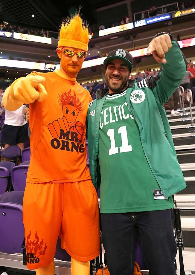 A Phoenix Suns fan and Boston Celtics fan give their best pose.