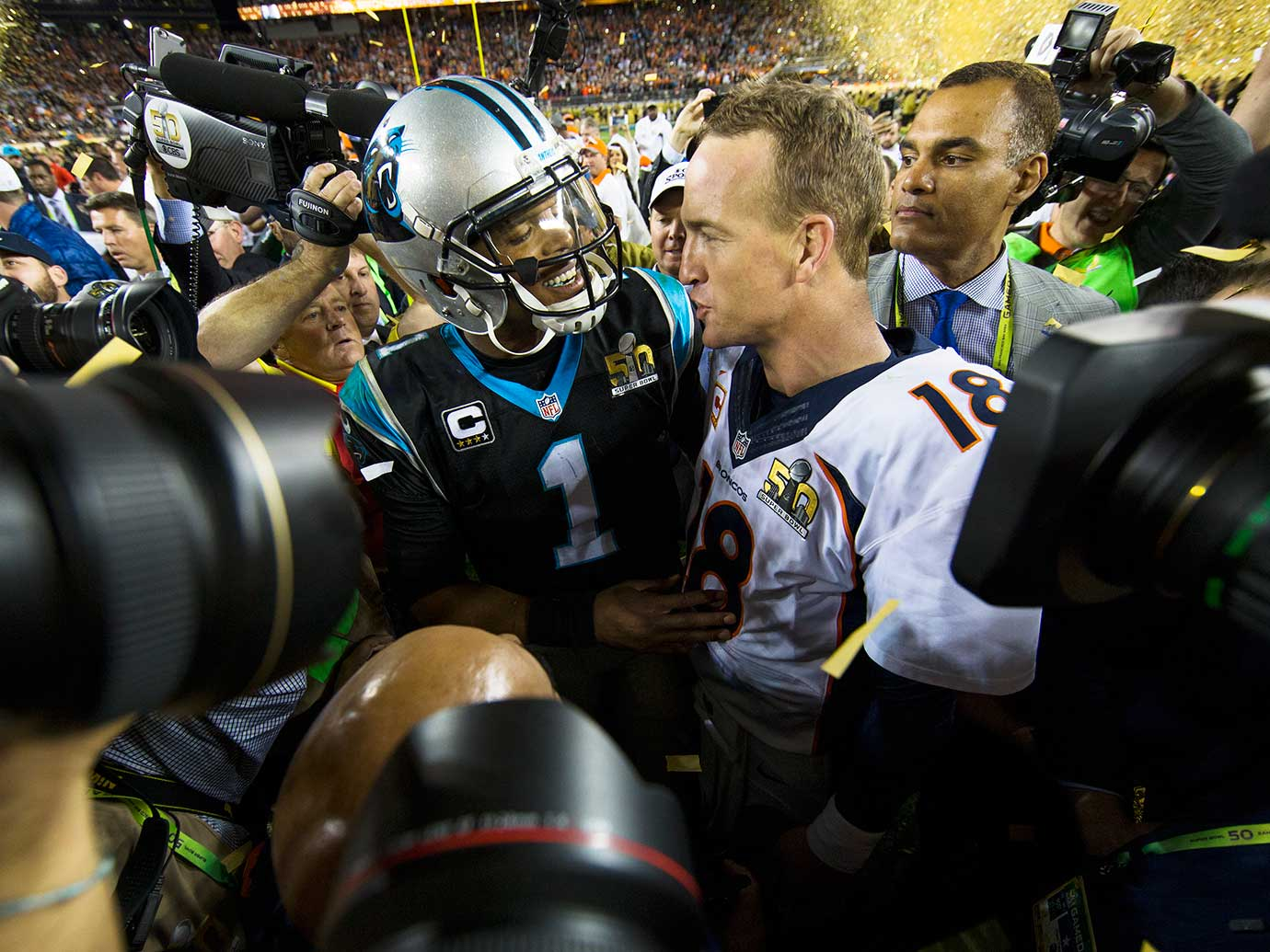 Cam Newton congratulates Peyton Manning.