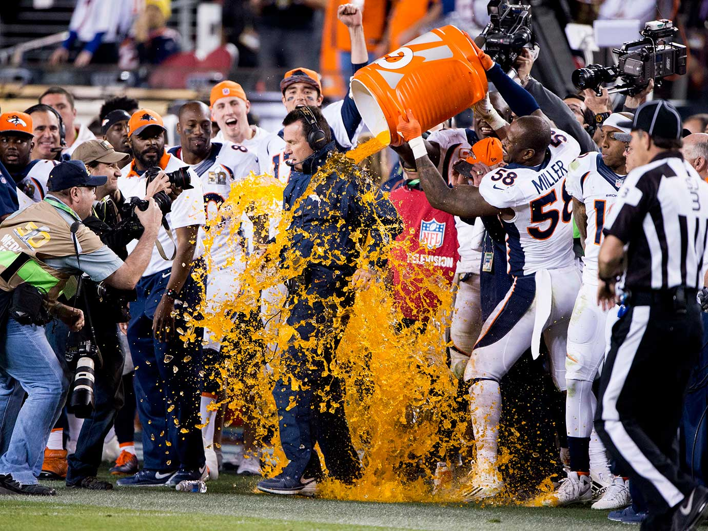 Von Miller douses coach Gary Kubiak after Denver defeated Carolina 24-10 in Super Bowl 50.