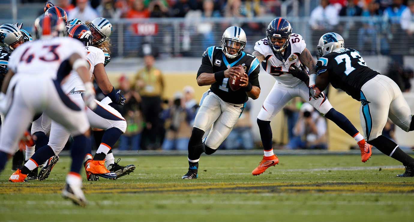 Cam Newton gets flushed out of the pocket. He led Carolina with 45 yards on the ground.