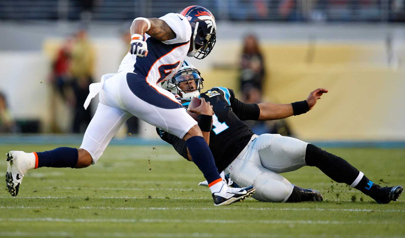 Cam Newton slides to avoid a would-be tackle.