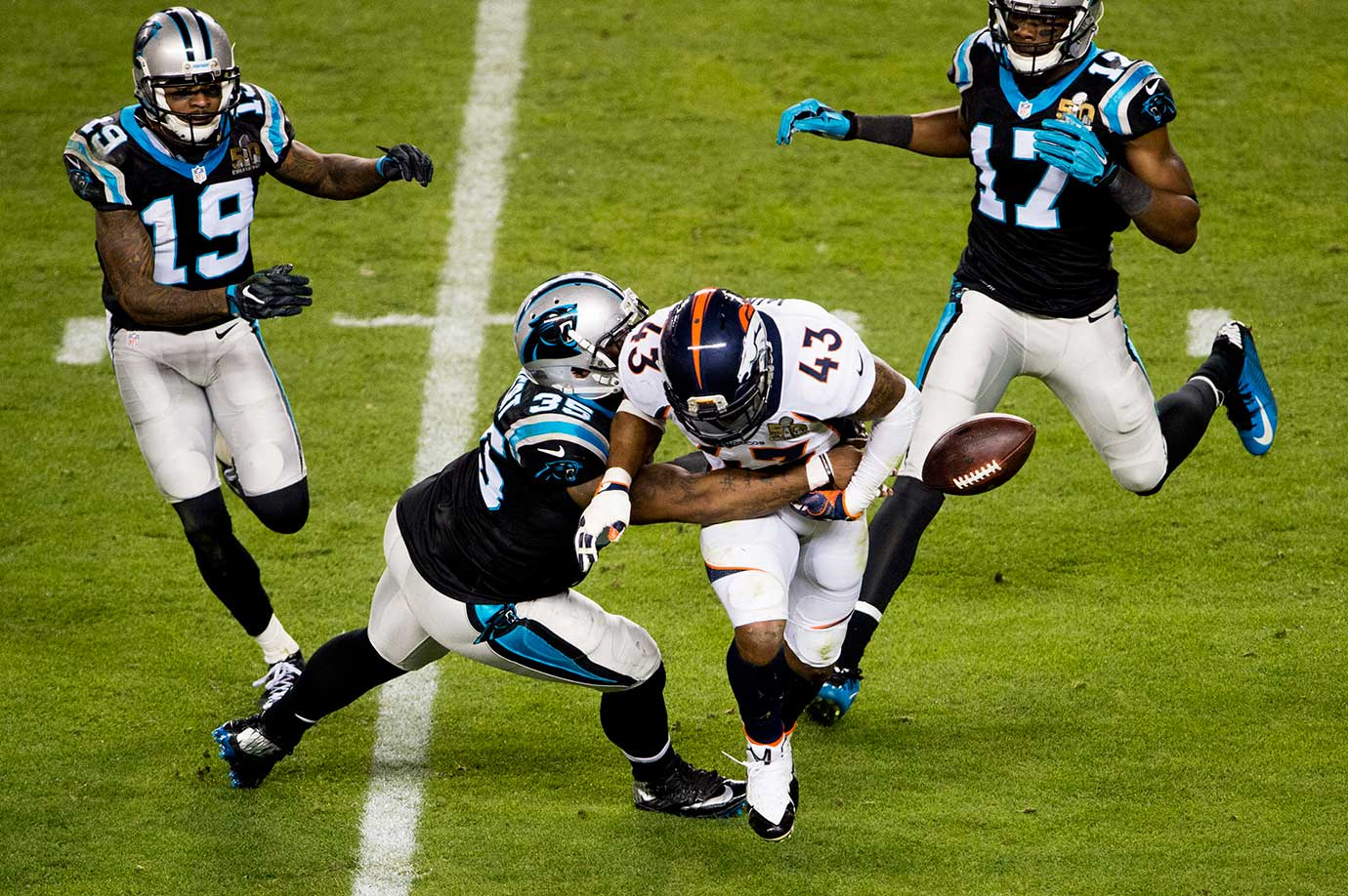T.J. Ward fumbles the ball while returning an interception.