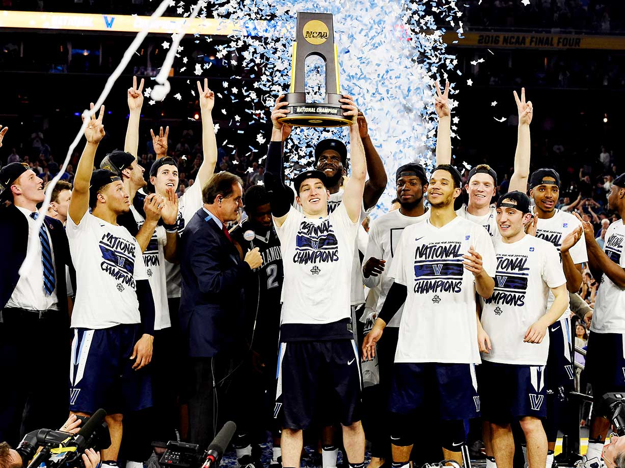Ryan Arciadiacono holds aloft the championship trophy with his Villanova teammates soaking in the moment.