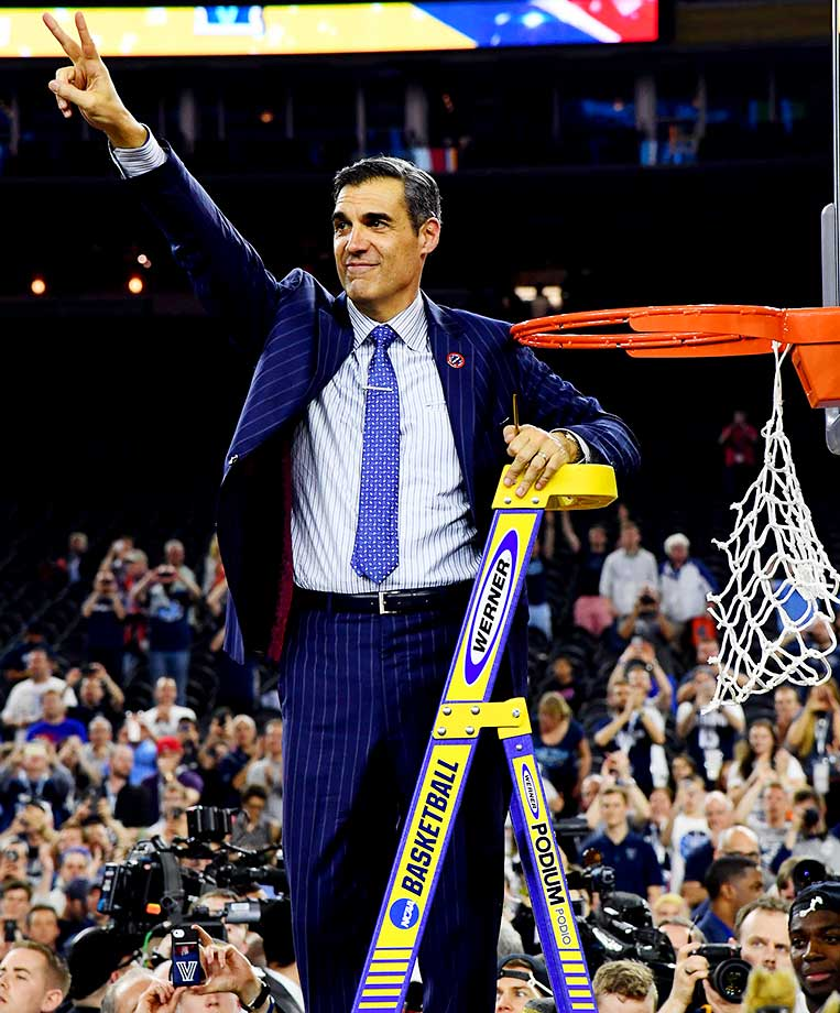 Villanova coach Jay Wright cutting down the nets.