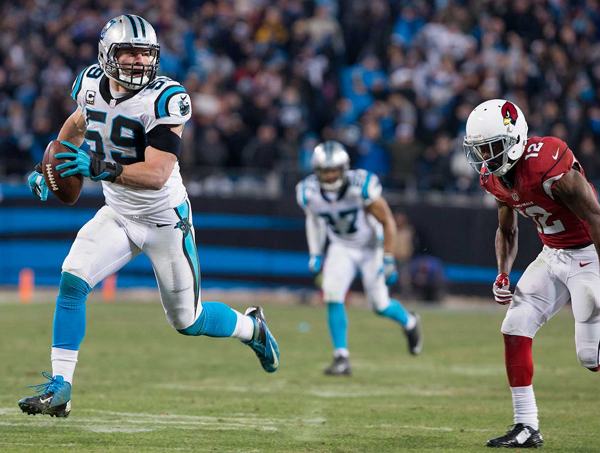 Middle linebacker Luke Kuechly runs back an interception for a touchdown.