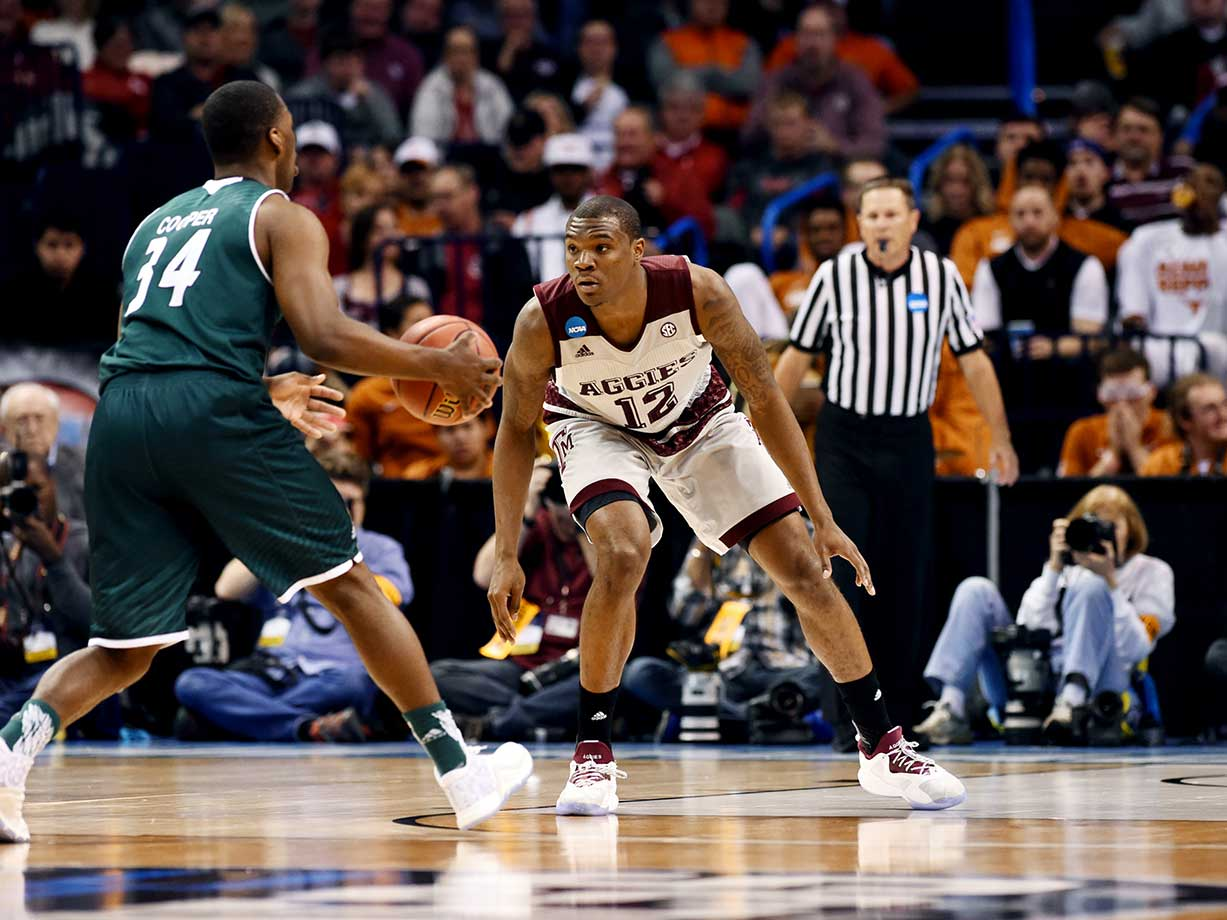 Jalen Jones of Texas A&M defends Charles Cooper of Green Bay as the Aggies won for the ninth time in their last 10 games.