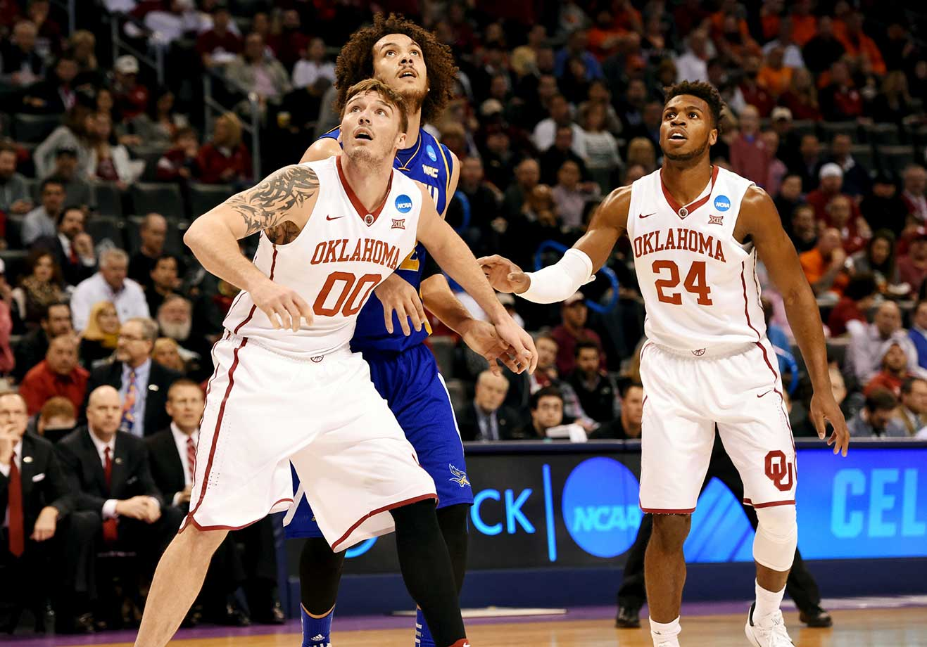 Ryan Spangler and teammate Buddy Hield box out Aly Ahmed of Cal State Bakersfield.