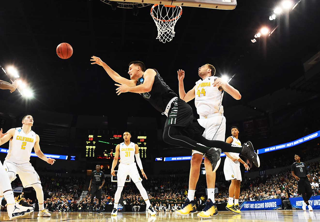 Stefan Jovanovic makes an acrobatic play during Hawaii's win over Cal.