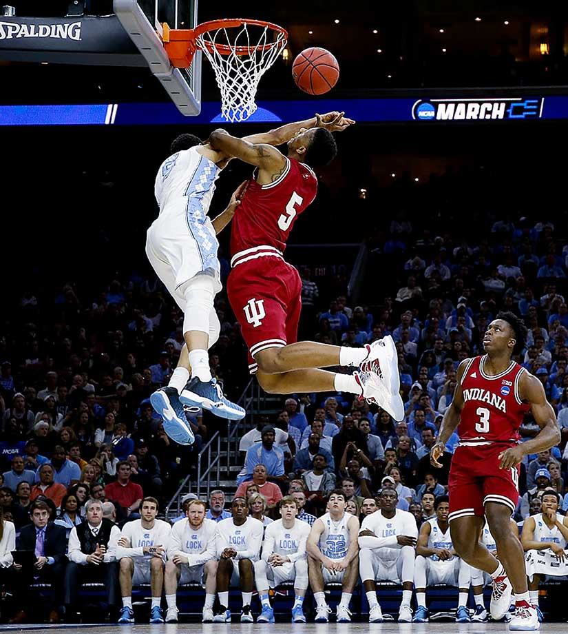 Troy Williams of the Indiana Hoosiers finds his path to the basket blocked by a North Carolina defender.