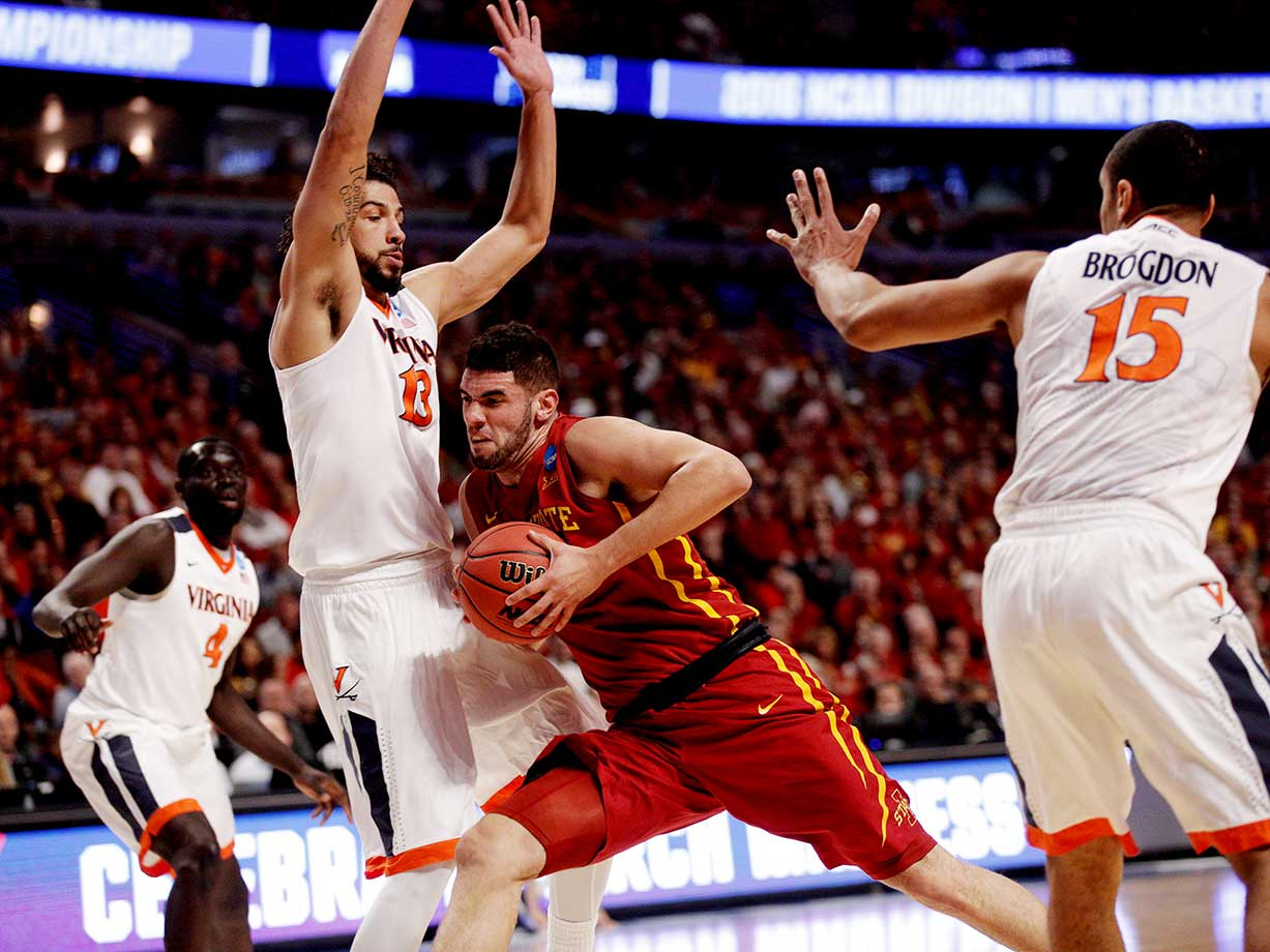 Georges Niang (31) of the Iowa State Cyclones muscles his way toward the basket against the Anthony Gill of Virginia.