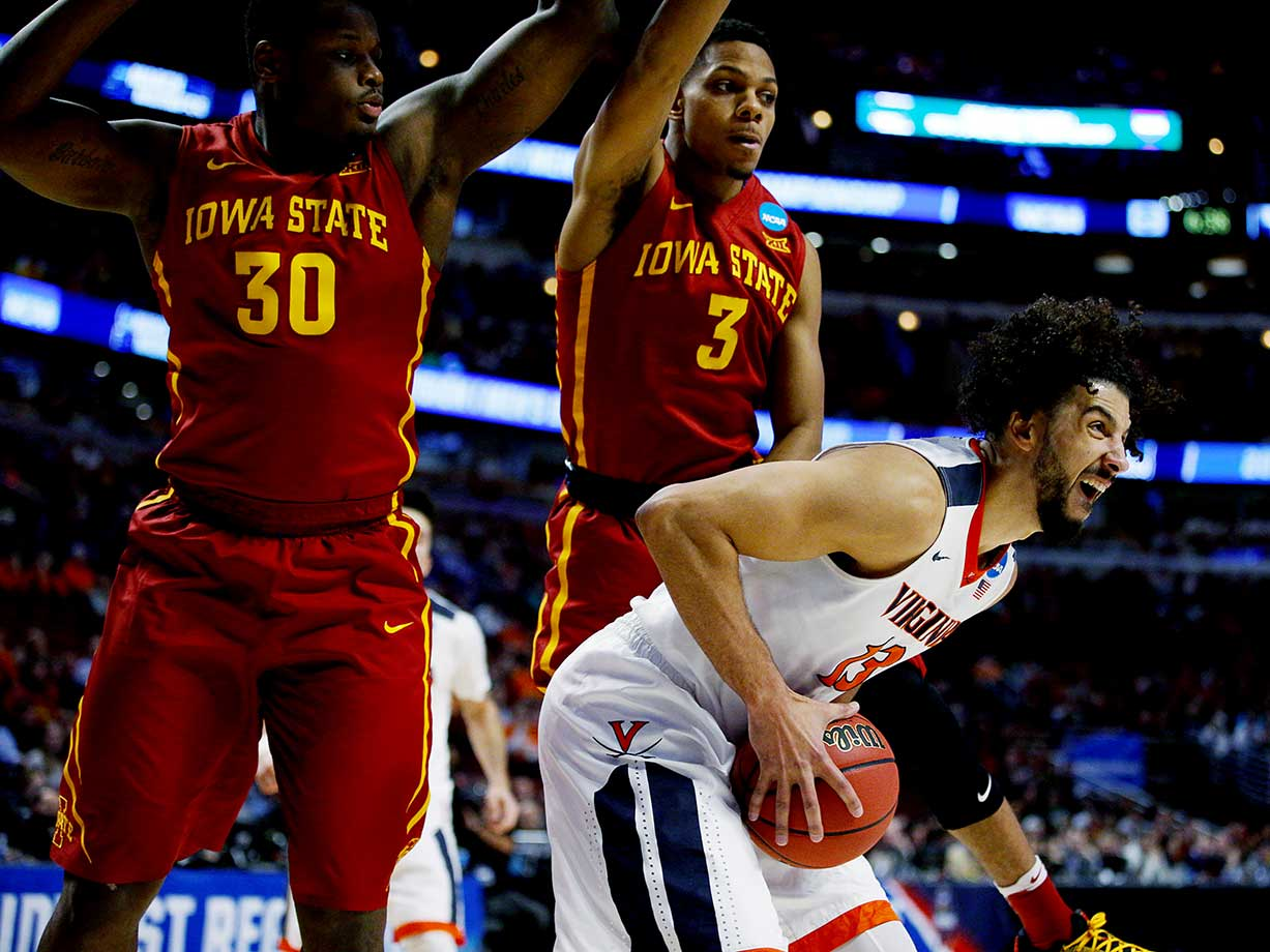 Virginia's Anthony Gill works for a shot against Deonte Burton (30) and Hallice Cooke of the Iowa State Cyclones.