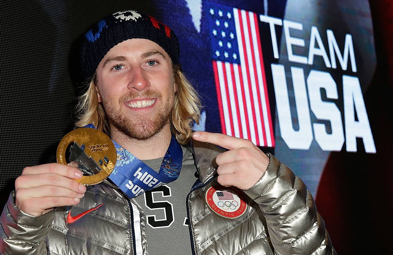Sage Kotsenburg shows off his gold medal while visiting the USA House in the Olympic Village.