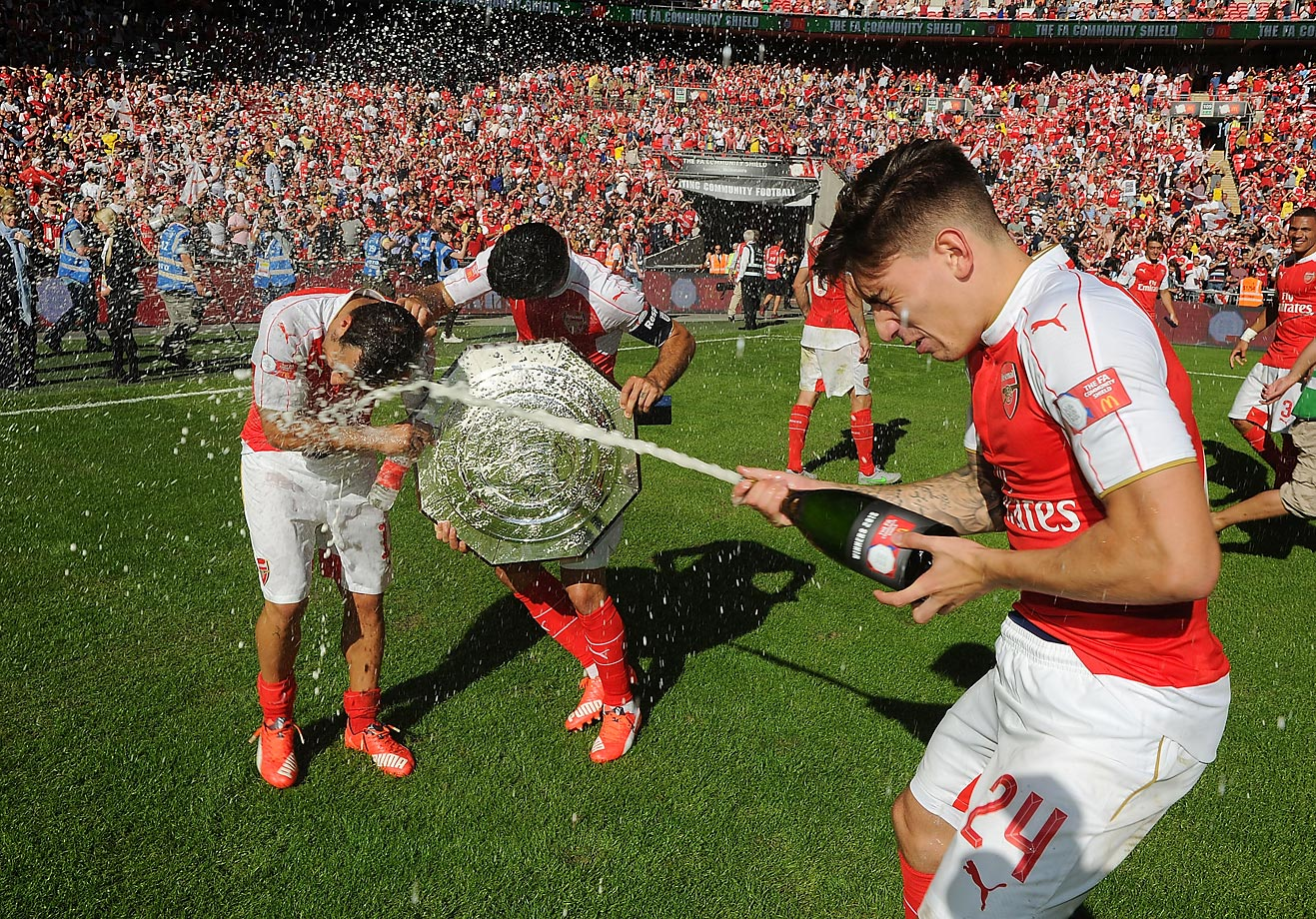 Santi Cazorla, Mikel Arteta and Hector Bellerin celebrate after the FA Community Shield match between Chelsea and Arsenal.