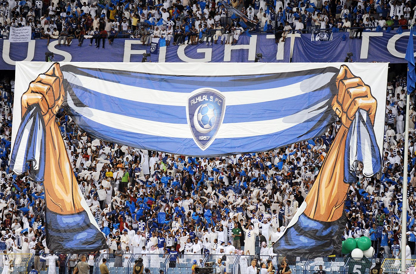 Fans of the Saudi Al-Hilal team celebrate after the scoring of a goal against Uzbekistan's Bunyodkor.