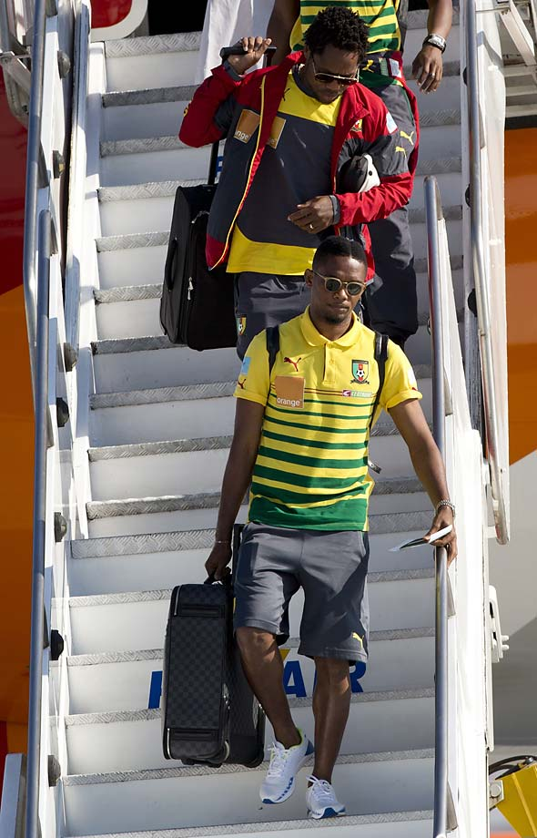 Samuel Etoío leaves the aircraft  as Cameroon's national team arrives at the Galeao Air Base in Rio de Janeiro on Monday, June 9. Cameroon's World Cup team refused to board a plane due to take them to Brazil on Sunday because of a long-running dispute over bonus payments for the tournament, forcing their national federation to take out a loan to meet their demands.