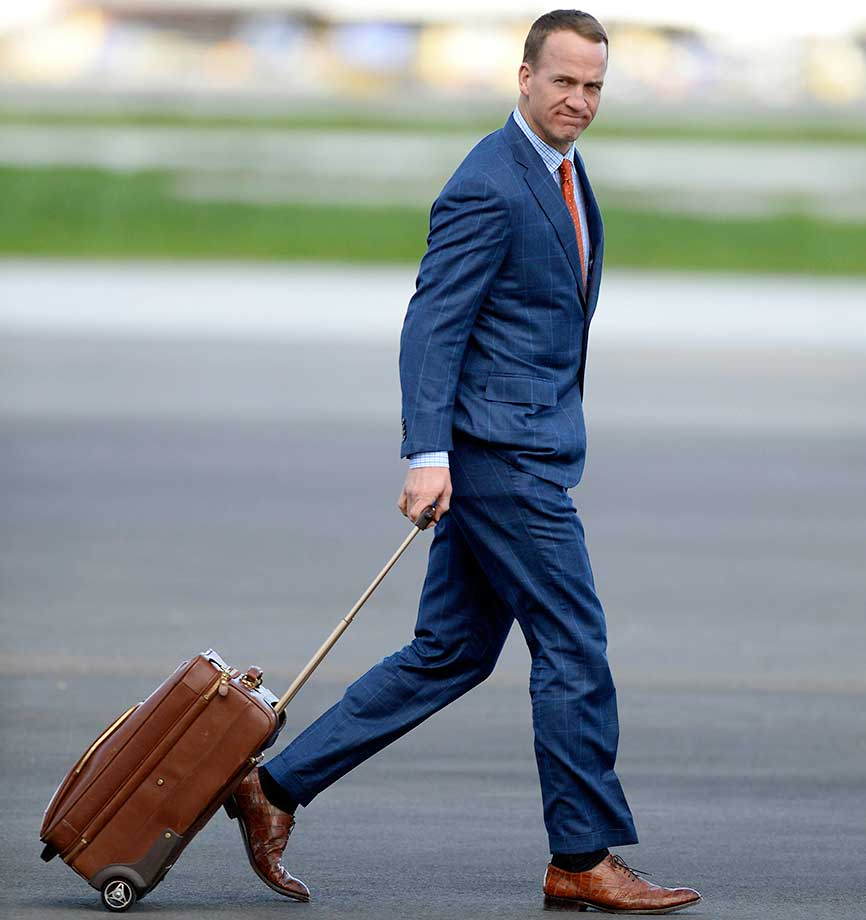 Denver Broncos quarterback Peyton Manning walks to a team bus after landing at Mineta San Jose International Airport on Sunday, Jan. 31, for Super Bowl 50.