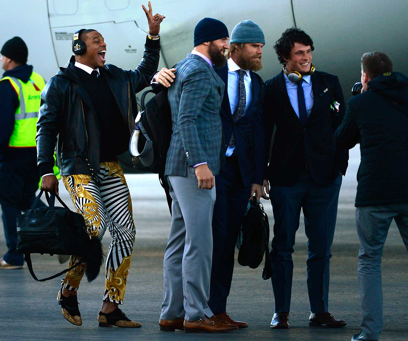 Carolina Panthers quarterback Cam Newton photo bombs his teammates as they arrive in California for Super Bowl 50.