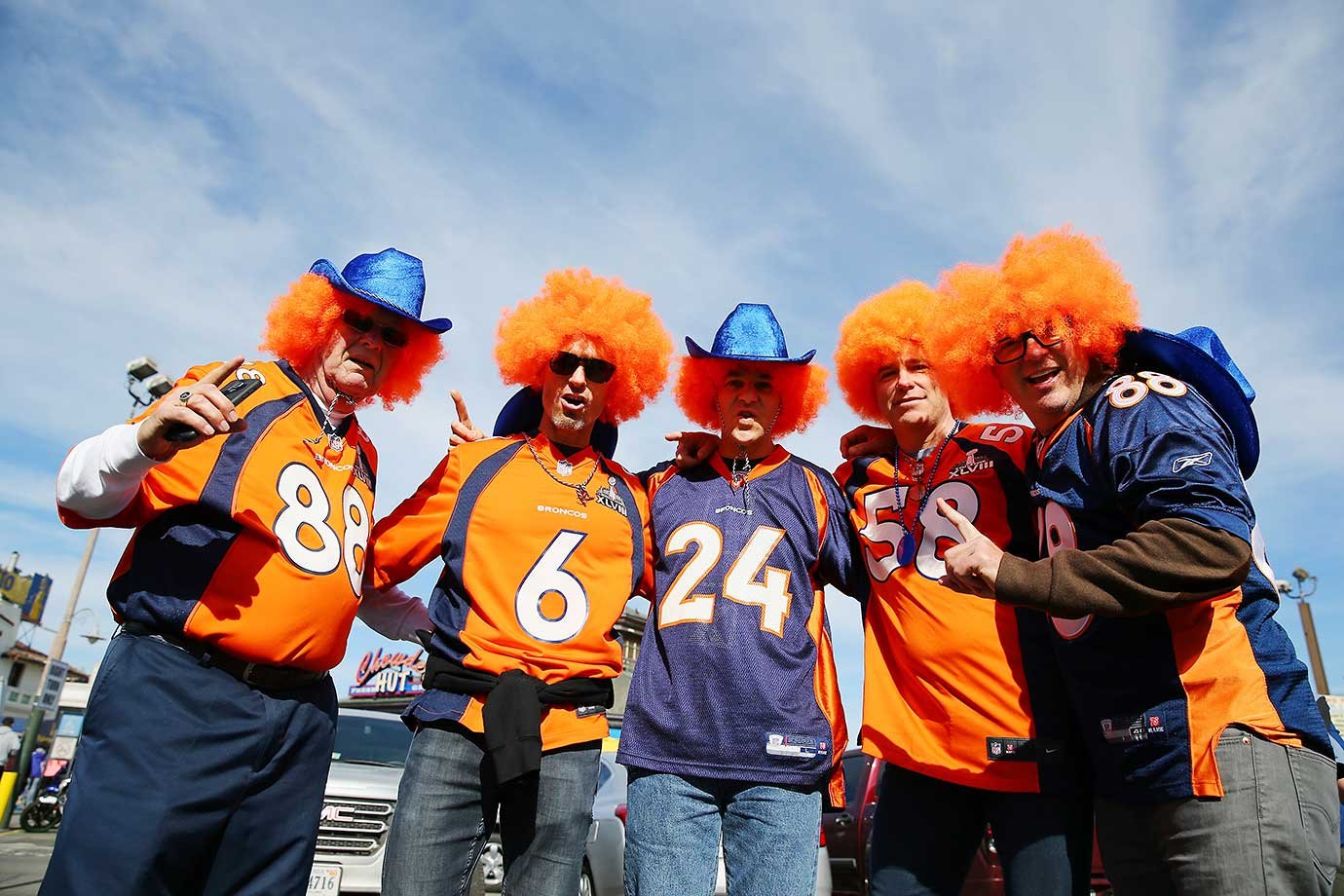 Denver Broncos fans pose on Fishermans Wharf.