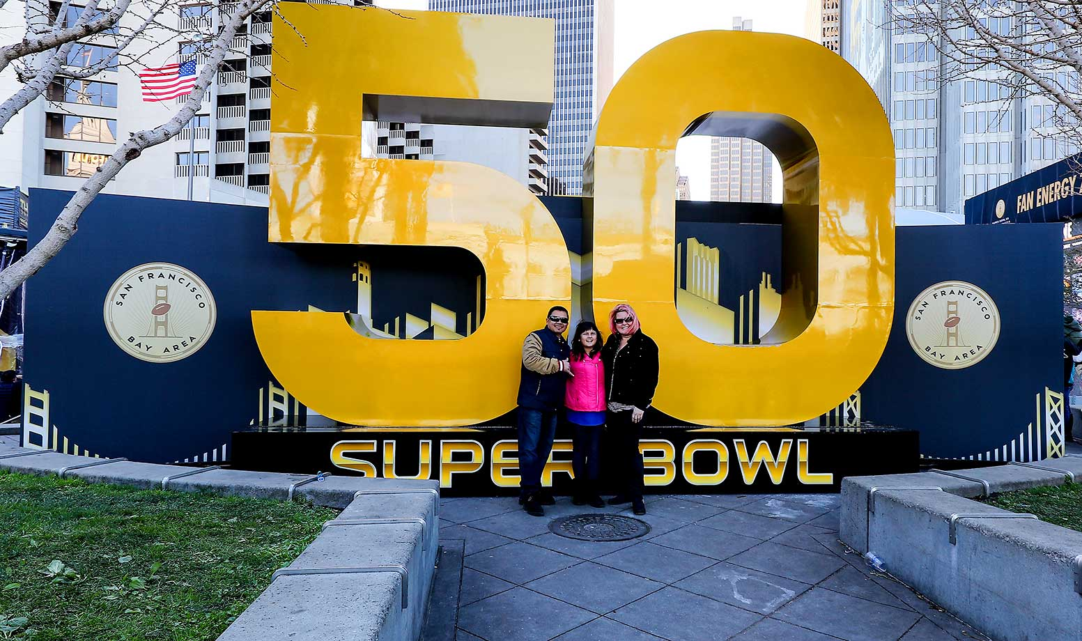 Fans pose for photo's in front of the Super Bowl 50 Logo in Super Bowl City.