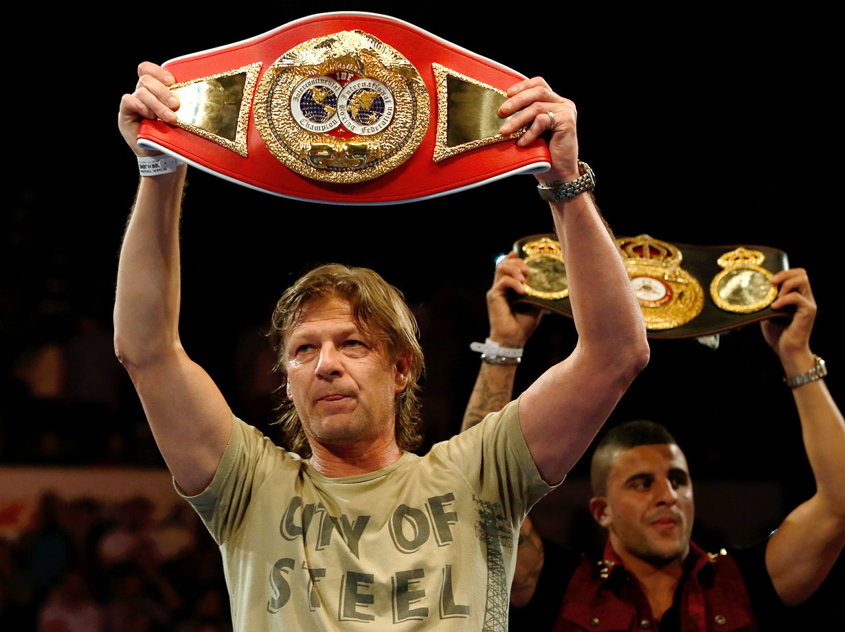 Sean Bean holds up a belt belonging to Kell Brook of England before the IBF Welterweight Title Eliminator Fight between Brook and Carson Jones of the USA at the Sheffield Motorpoint Arena on July 7, 2012 in Sheffield, England.