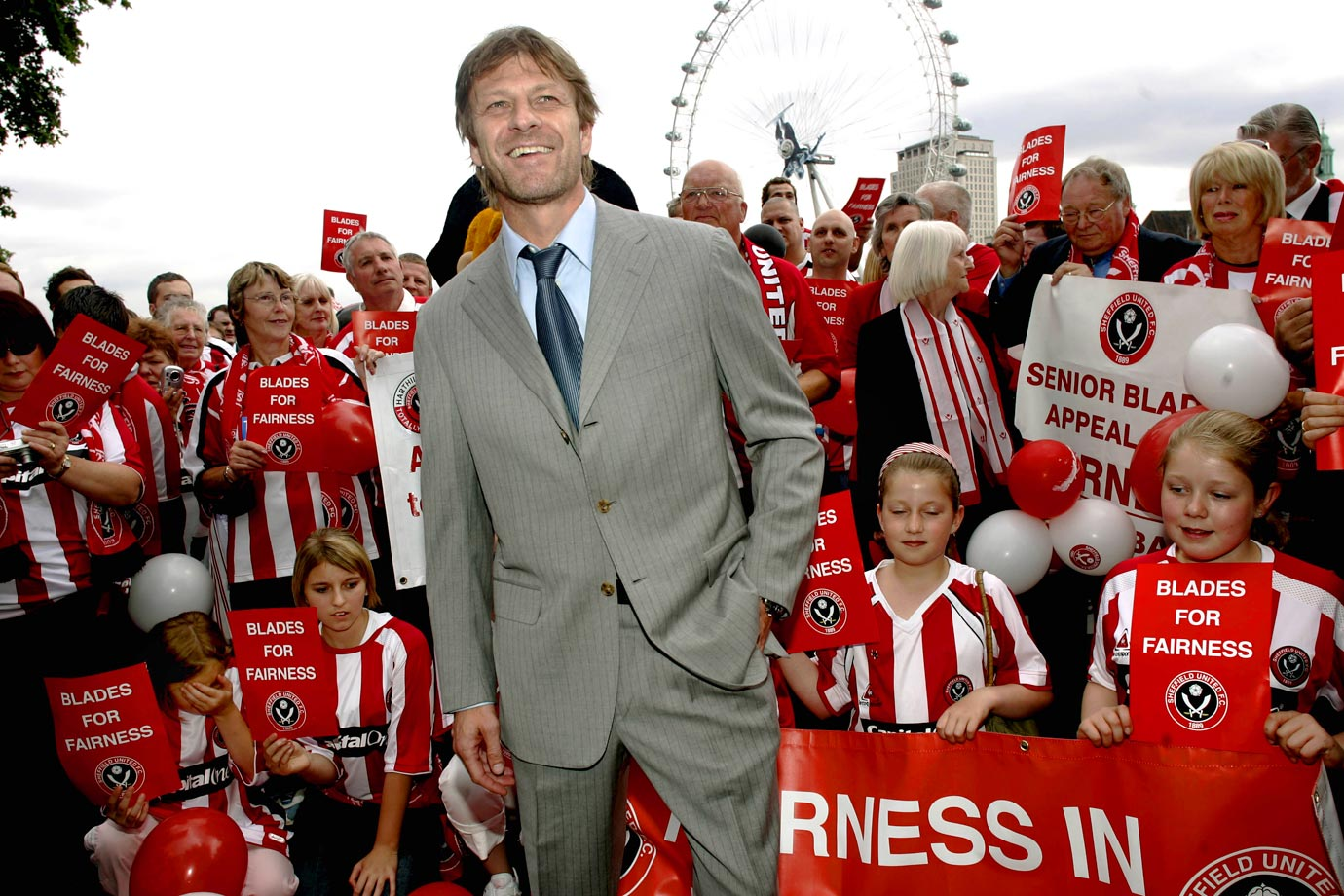 Sean Bean poses with Sheffield United fans outside the Houses of Parliament on June 13, 2007 in London.
