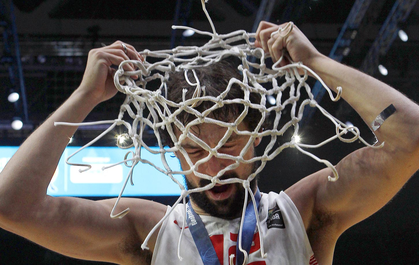 Sergio Llull of Spain uses the net as a hat  after his team beat Lithuania 80–63 in the Eurobasket European Championship final game.