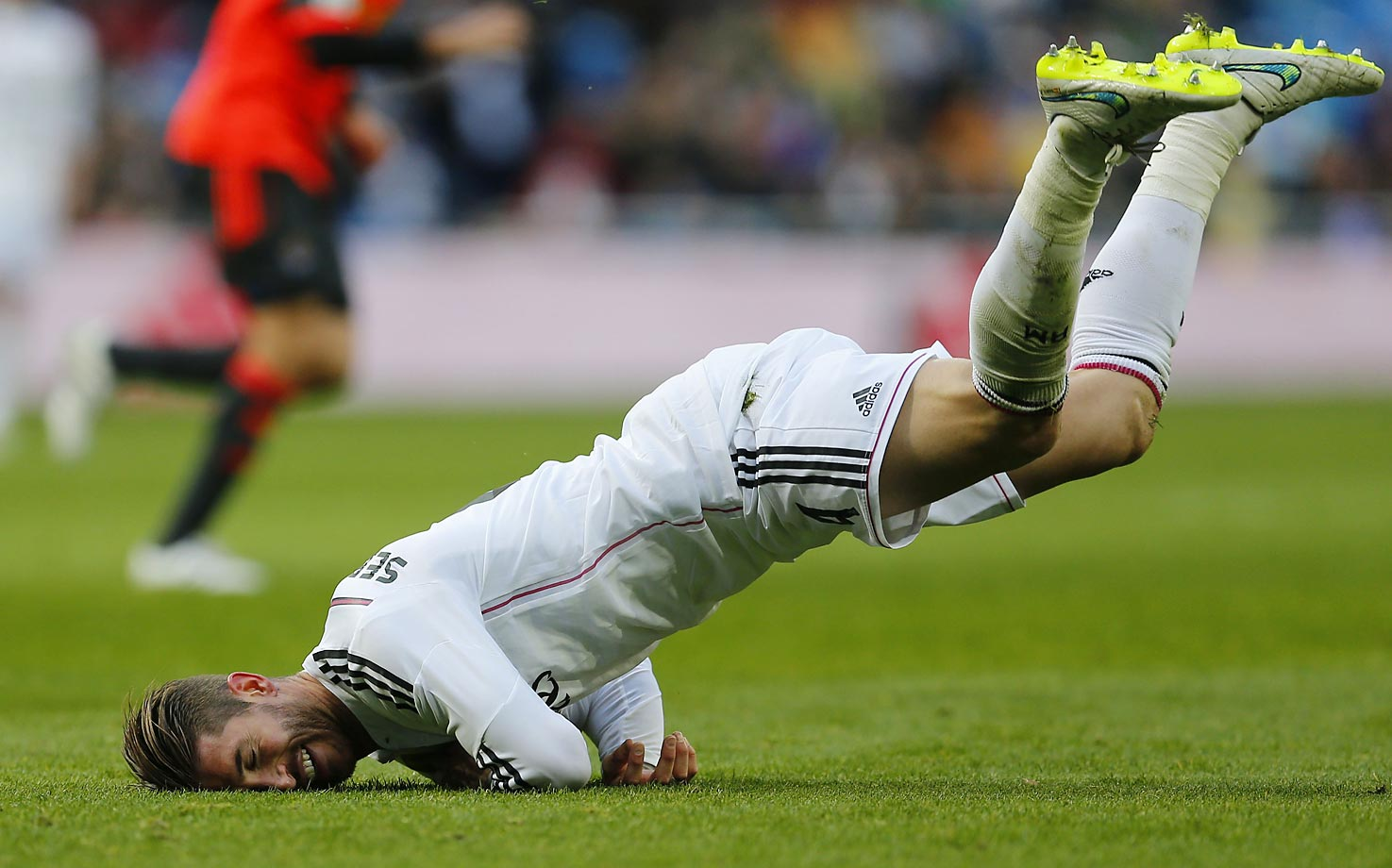 Real Madrid's Sergio Ramos makes a face-plant during a Spanish La Liga soccer match between Real Madrid and Real Sociedad.
