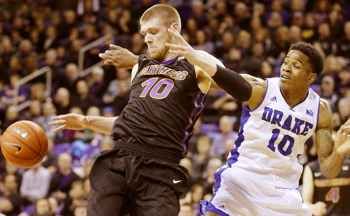 Northern Iowa forward Seth Tuttle fights for a rebound with Drake forward Trevor Berkeley.