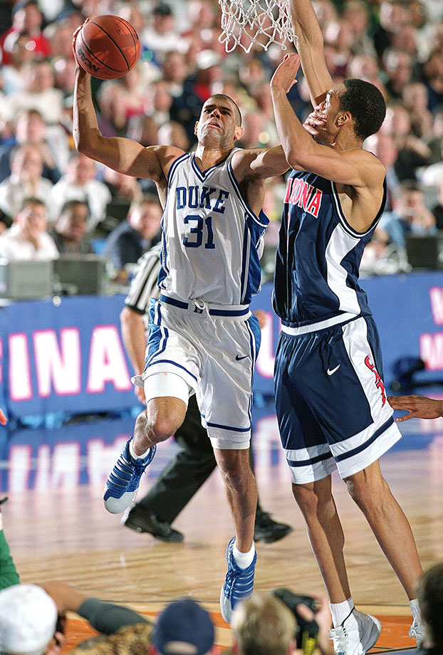 Battier excelled in many areas on and off the court, but most of all, Battier was a winner. The forward won 131 games, the most in ACC history, and his Blue Devils teams never failed to reach at least the Sweet 16. He had 18 points and 11 boards in Duke's 82-72 win over Arizona in the 2001 national championship game. Battier did a little bit of everything for Duke, scoring 19.9 points with 7.3 rebounds, 2.1 steals and 2.3 blocks per game along with a 41.9 three-point percentage his senior year. The three-time NABC Defensive Player of the Year could lock down opponents without fouling (2.0 career fouls per game). He capped off his senior season by winning the Naismith and Wooden awards and a national title. Battier averaged 22.5 points and 10.2 rebounds during Duke's 2001 title run.