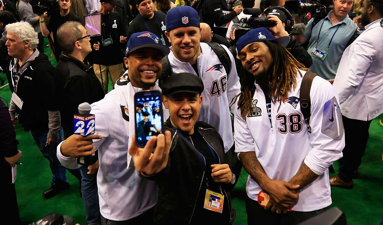 Shane Vereen (34),  James Develin (46) and  Brandon Bolden pose for a selfie at Super Bowl XLIX Media Day.