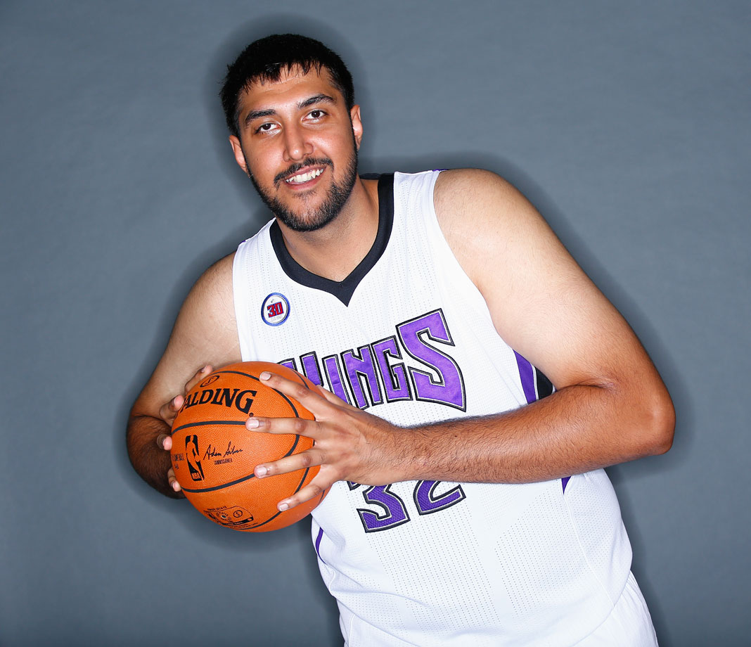 That's not a child-sized ball. That's just a 7-foot-5, 355-pound man.