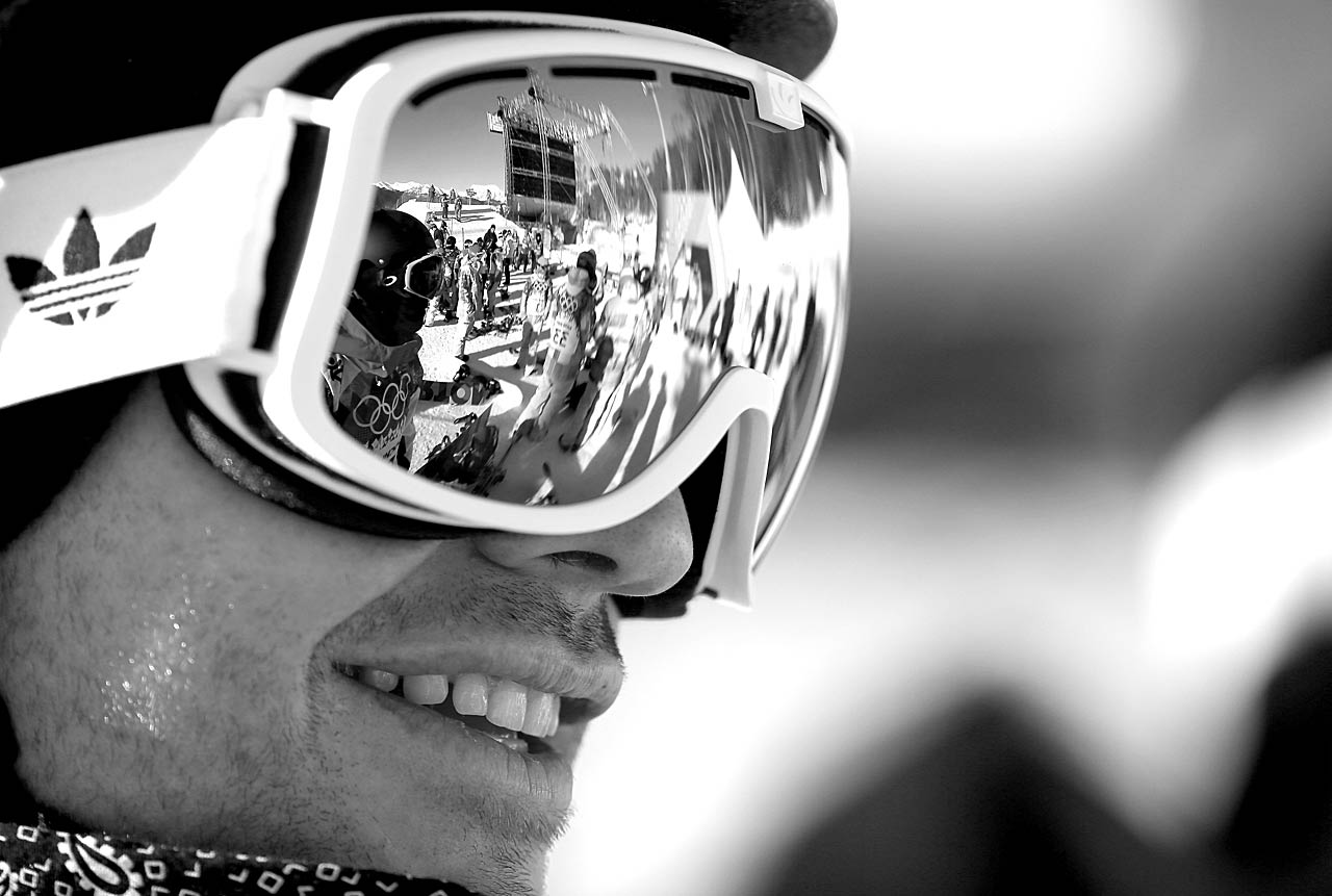 Snowboarder Dominic Harington of Great Britain looks on during Day 1 of the Sochi 2014 Winter Olympics.